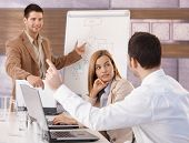 Happy young businesspeople having business training in meeting room.?