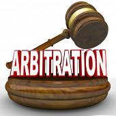 A gavel comes down on the word Arbitration to symbolize the binding decision of a third party to settle a case