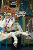 stock photo of merry-go-round  - Close up of carousel horse on merry go round - JPG
