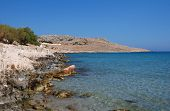 The rocky coastline by Pondamos beach at Emborio on the Greek island of Halki.