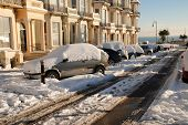 ST.LEONARDS-ON-SEA, ENGLAND - DECEMBER 3: Snow covers the road and cars in Warrior Square on Decembe