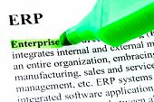 ERP enterprise resource planning definition highlighted by green marker on white paper background