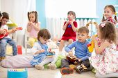 Group Of Smart Kids Age 3-4 Years Playing Diverse Musical Toys. Early Musical Education In Kindergar poster