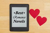 Best Romance Novels Message, An E-reader On A Desk With Two Hearts And Text Best Romance Novels With poster