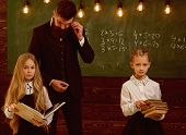 Education. Education Process At School Lesson, Teacher Gives Education To Little Girls. Improving Yo poster