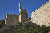 The ancient walls surrounding Old city in Jerusalem and the Tower of David