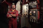 Ship Mechanic Staying Near Main Engine In Engine Room. poster