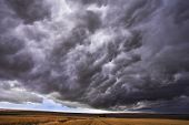 The thundercloud closes the sky above boundless plain in state of Montana. More magnificent pictures