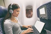 Plane passenger business woman professional working in airplane cabin during flight with in-flight w poster