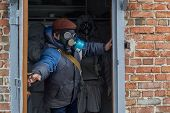 People In Gas Masks And Protective Suits Are Saved In A Bunker During A Chemical Hazard. Chemical Ha poster