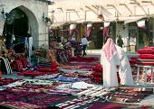 A view of Souq Waqif, Qatar, early in the morning, with flags flyiing in preparation for national da