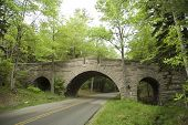stone carriage bridge going over road at Acadia National Park