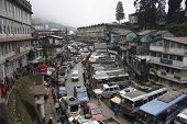DARJEELING - CIRCA DECEMBER 2008: View of main street, bus-station and bazaar circa December 2008 in