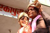 HARIDWAR, INDIA - JANUARY 14: The groom (R) and his little friend (L) in a traditional Indian weddin