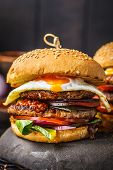 Homemade Meat Burgers With Egg, Sauce And Vegetables On A Dark Background, Vertical, Macro. poster