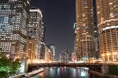 Downtown Chicago City Skyline Along The Chicago River At Night poster