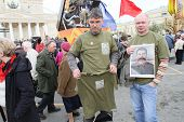 MOSCOW - MAY 1: Communist party supporters take part in a rally marking the May Day, a portrait of Soviet dictator Josef Stalin, May 1, 2010 in Moscow, Russia.