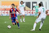 MOSCOW - MAY 10: CSKA's Evgeniy Aldonin (L) in action during their team's Russian football champions