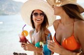 Beautiful Fit Girls In Summer Day Having Fun And Cocktails On Beach poster