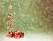 Christmas Greeting Card With Gold Metal Firtree And Presents On The Abstract Background