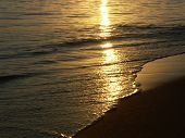Sun Lapping The Shore