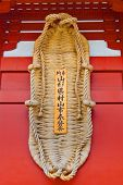 TOKYO, JAPAN - MARCH 30: Giant grass shoes on the wall at Sensoji temple which dedicated from Yamaga