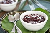 Black sticky rice pudding with coconut milk