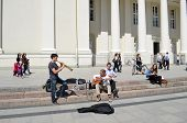 Students Play Pipe Guitar. Street Music Day