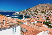stock photo of hydra  - Overview of the beautiful island of Hydra Greece showing its main town and port - JPG