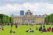 Parisians And Tourists On Lawn Champs De Mars In Paris. France