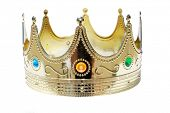 stock photo of crown jewels  - A Genuine Plastic King or Queen crown in Gold Plastic with Colorful Plastic Jewels isolated on white with room for your text - JPG