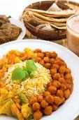 Indian food biryani rice, mutton curry, chapatti and milk tea. Indian dining table.
