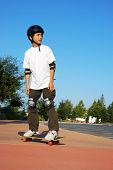 Teen Boy On Skateboard