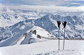 Ski Poles And Gloves In Alps