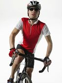 Bicyclist riding bicycle against white background