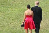 Couple In Formal Attire Walking Away