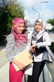foto of muslimah  - beautiful young muslim student happy together working - JPG