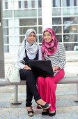 image of muslimah  - beautiful young muslim student happy together working - JPG