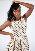 Black woman in spotted dress