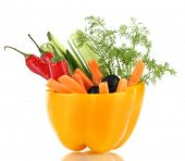 Assorted raw vegetables sticks in pepper bowl isolated on white