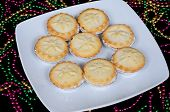 Mince pies on a white plate.