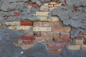 stock photo of earth structure  - Mix of traditional bricks and natural stone bricks comprising an older rustic exterior house wall - JPG