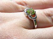 Peridot Ring On Finger Closeup