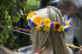 Wreath From Flowers On The Head At The Girl.