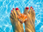 Relaxing day Relaxing day; underwater picture of feet in a swimming pool with sea shell