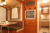pic of motor coach  - interior of motor home with dining table and dishes - JPG