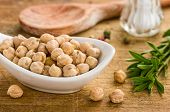 Bowl with chickpeas on a wooden background