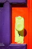Colorful door with yellow knob