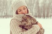 Woman Holds A Cat On Nature