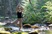 Woman Doing Yoga Near River